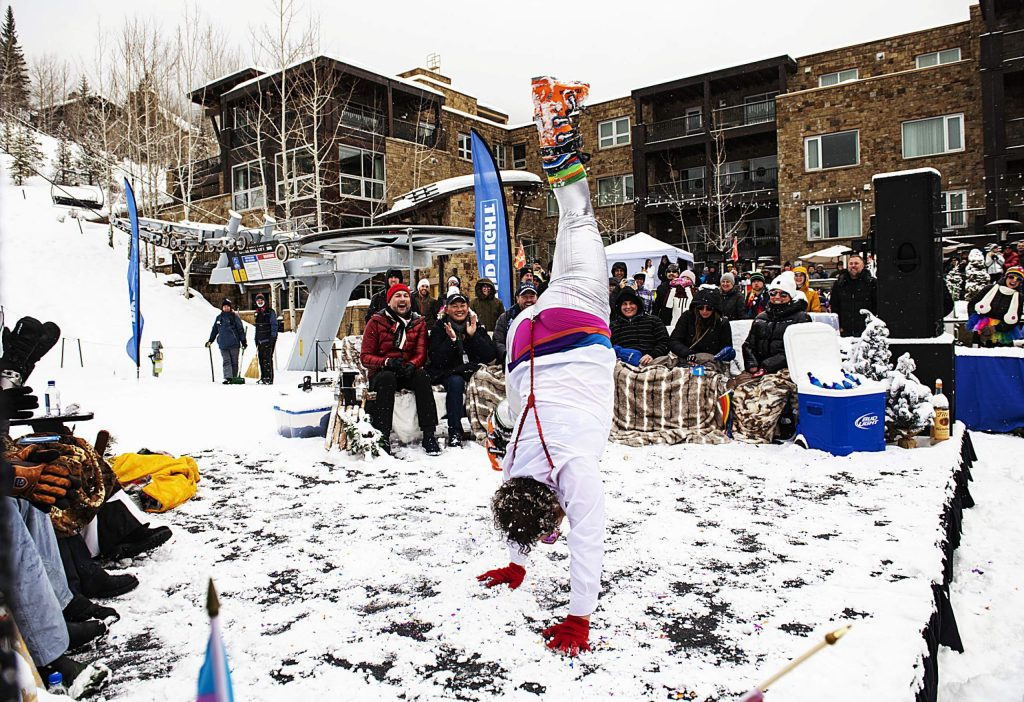 Chris Ryerson performs onstage for the judges and audience during the Gay Ski Week downhill costume contest on Friday, Jan. 17, 2020. (Kelsey Brunner/The Aspen Times)