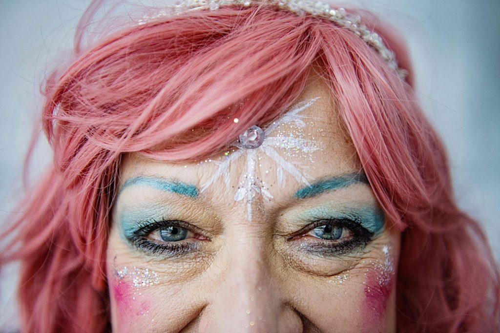 Noemi Kosmowski poses for a portrait in face painting tent during the third day of Winterskol on the walking mall on Saturday, January 11, 2020. Kosmowski's favorite hobby is doing her makeup and she says she spends approximately half an hour every day putting it on. (Kelsey Brunner/The Aspen Times)