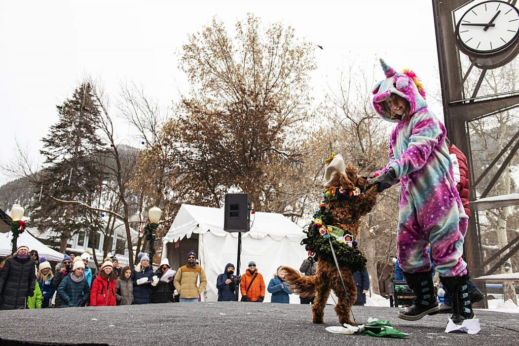 Edy Goss, 8, dances with Rusty on the stage during the Canine Fashion Show at Winterskol on Saturday, January 11, 2020. (Kelsey Brunner/The Aspen Times)