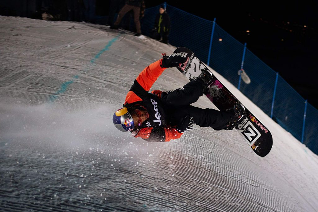 "Wearing rose-colored heart glasses, X Games rookie Zeb Powell of Waynesville, North Carolina hucks his ""coffin slide"" trick off of the big air course knuckle at Buttermilk Ski Area in Aspen at the X Games Aspen 2020 knuckle huck competition on Sunday night. Powell won gold."
