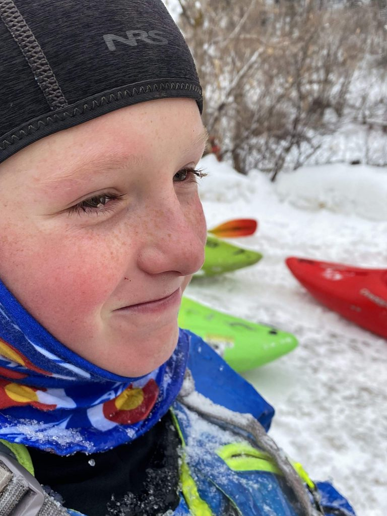 Bryce Smaic, 12, exited the water with ice in his eyelashes and a smile on his face on Wednesday. It was his first time participating in the annual New Year's Day event.