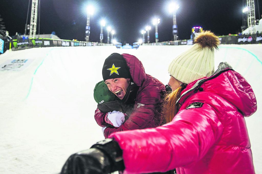 Alex Ferreira celebrates with friends and his mother, Colleen Delia, right, at the bottom of the X Games superpipe after he took first place on Thursday night in the men's ski superpipe finals.