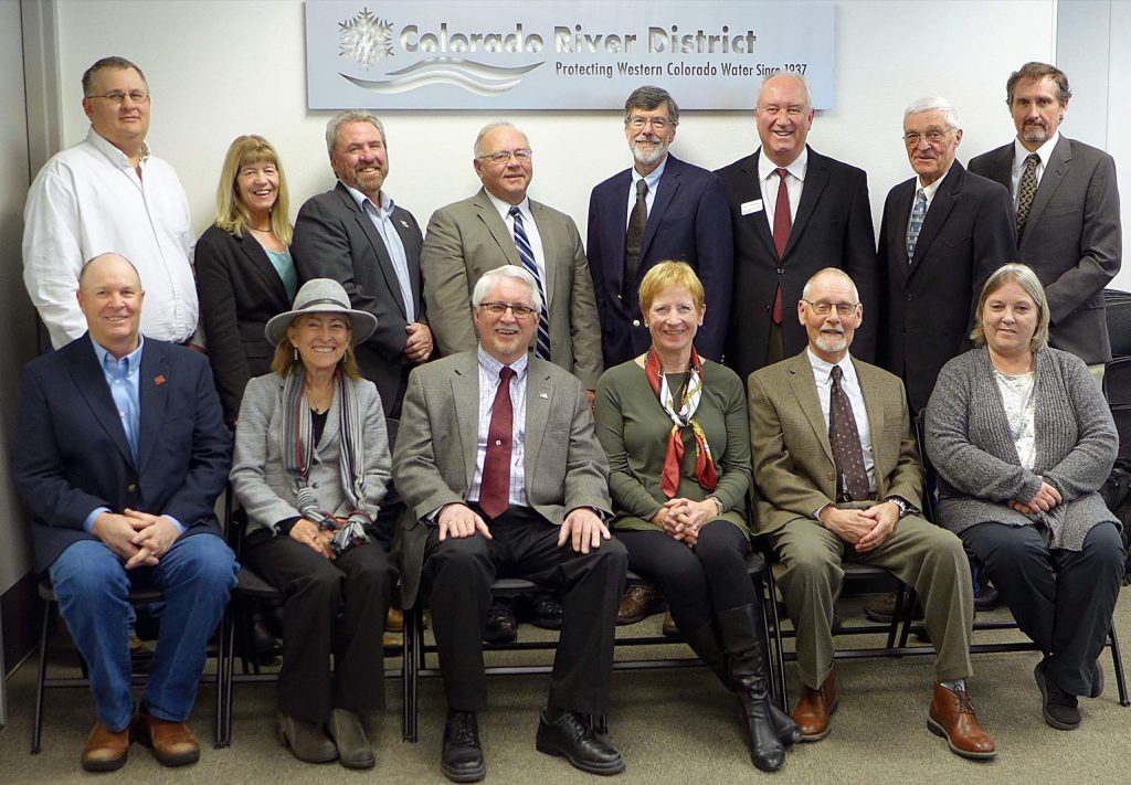 Fourteen of the 15 directors of the Colorado River Water Conservation District, gathered for a 2019 meeting. The directors are appointed by county commissioners in 15 Western Slope counties. Back row, from left, Alden Vanden Brink, Rio Blanco County; Karn Stiegelmeirer, Summit; Doug Monger, Routt; Marc Catlin, Montrose; John Ely, Pitkin; Steve Acquafresca, Mes; Bill Trampe, Gunnison; Stan Whinnery, Hinsdale. Front row, from left, Mike Ritschard, Grand; Kathy Chandler-Henry, Eagle; Dave Merritt, Garfield; Martha Whitmore, Ouray; Tom Alvey, Delta; Rebie Hazard, Saguache; Not shown, Tom Gray, Moffat County.