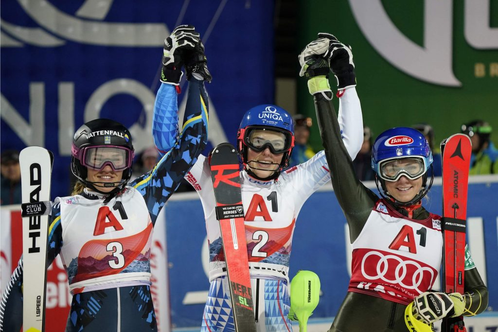 From left, second placed Sweden's Anna Swenn Larsson, the winner Slovakia's Petra Vlhova, and third placed United States' Mikaela Shiffrin celebrate after completing an alpine ski, women's World Cup slalom in Flachau, Austria, Tuesday, Jan. 14, 2020. (AP Photo/Giovanni Auletta)