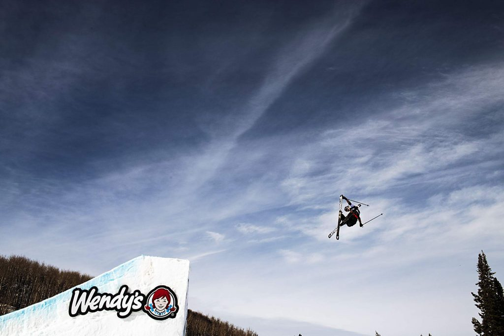Teal Harle hits the first jump on the slopestyle course during the men's ski qualifying event on Friday, Jan. 24, 2020.(Kelsey Brunner/The Aspen Times)
