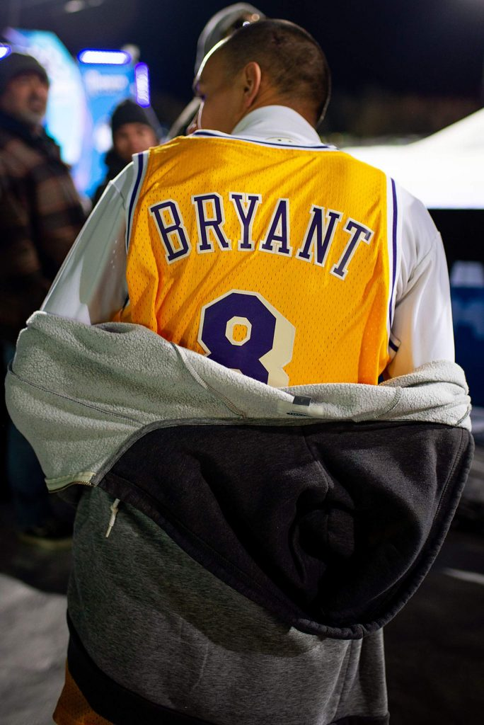 A fan at the snow bike best trick final wears a Kobe Bryant jersey.