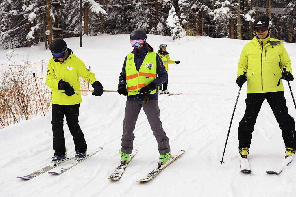 Aspen Skiing Co. CEO Mike Kaplan (middle) recently joined members of the Tennessee School for the Blind at Elk Meadows in Snowmass to experience firsthand Challenge Aspen's program for the disabled. Kaplan blindfolded himself and took some short runs to sample what a visually impaired individual experiences on the hill.