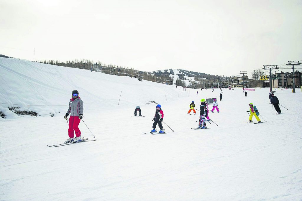 A kids' ski school class makes turns at Snowmass in December 2016.