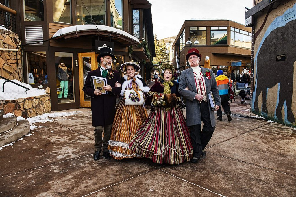 What the Dickens? Carolers! Keith Willamson, left, Lauren Bales, Kathleen Kennedy, and Tom Loveless sing holiday songs as they walk through the Snowmass Village Mall on Friday, December 20, 2019.