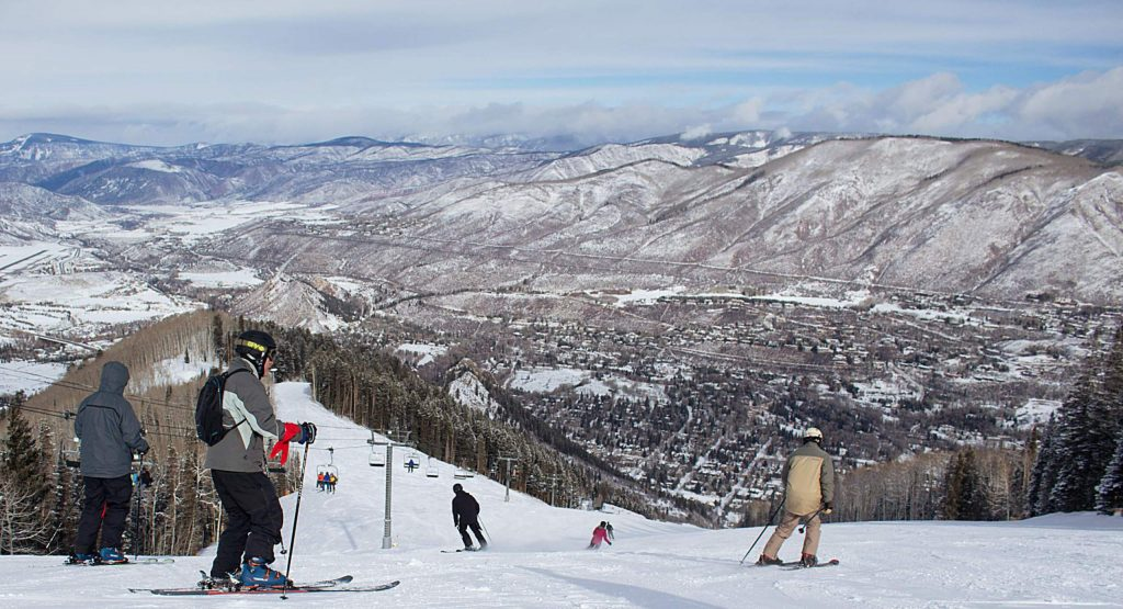 Skiers turn down Ruthie's Run on Aspen Mountain Sunday as part of the first