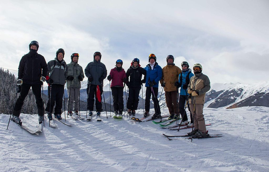 A group skiing as part of the first