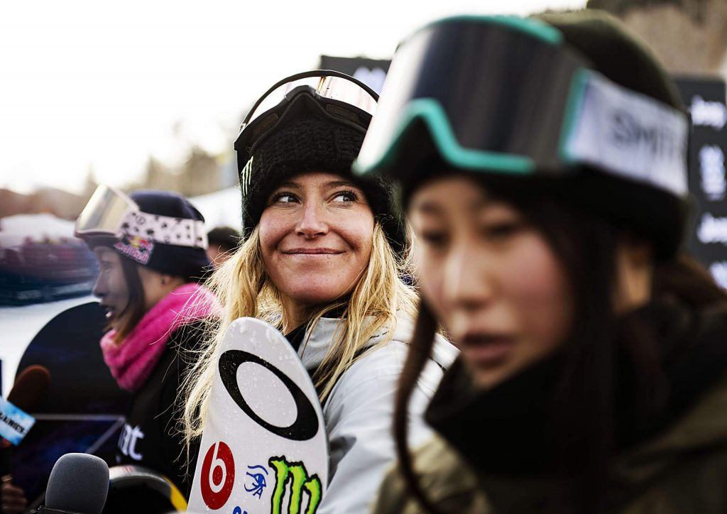 X Games women's snowboard slopestyle gold medalist Jamie Anderson, center, smiles while Miyabi Onitsuka, left, and bronze medalist Kokomo Murase give an interview on Saturday, Jan. 25, 2020.