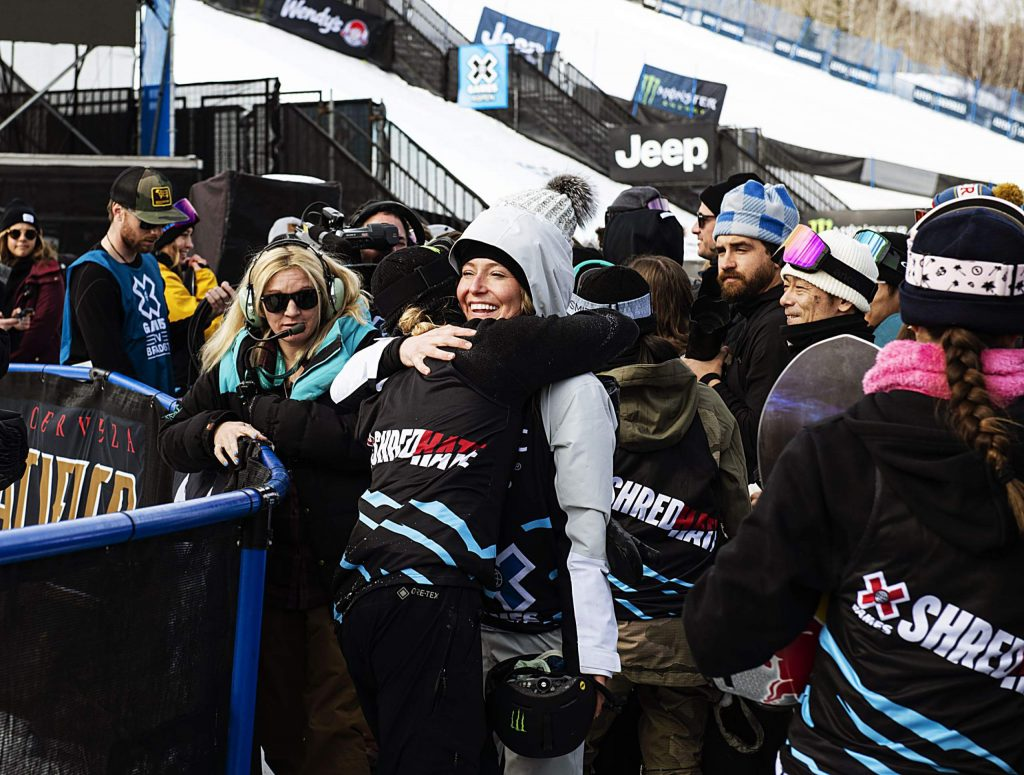 X Games gold medalist Jamie Anderson hugs competitor Zoi Sadowski-Synnott after the end of the women's snowboard slopestyle event on Saturday, Jan. 25, 2020.