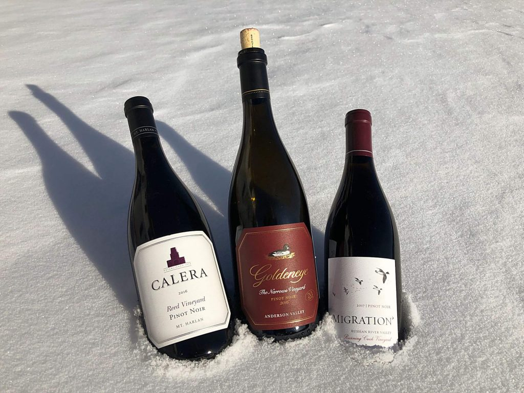 Nestled in a winter's snow are three different pinot noir wines. Each comes from a different California growing region, each is made by a different winemaker and each reflects a different style. But all three of these pinots are the product of one company, the Duckhorn Wine Company. Try each and, if you pay attention, you will unlock different flavors, and yes, stories.