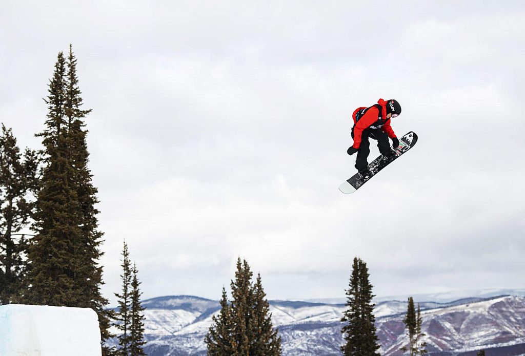 X Games snowboarder Red Gerard hits a jump during the men's snowboard slopestyle final on Saturday, Jan. 25. Gerard took home a bronze medal.