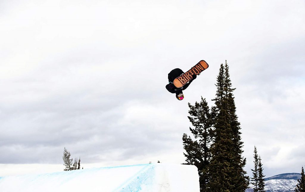 Darcy Sharpe hits a jump during the men's snowboard slopestyle final on Saturday, Jan. 25. Sharpe took home the gold medal.