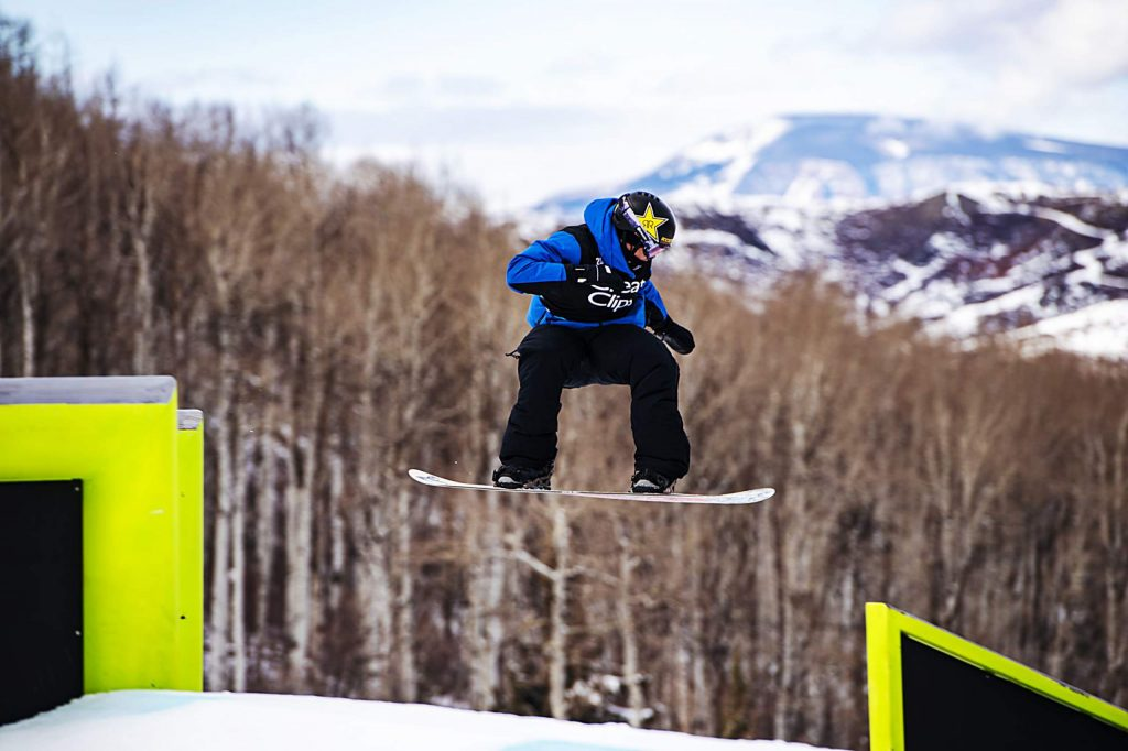 X Games silver medalist Mons Røisland hits the monster rails during the men's snowboard slopestyle finals on Saturday, Jan. 25.