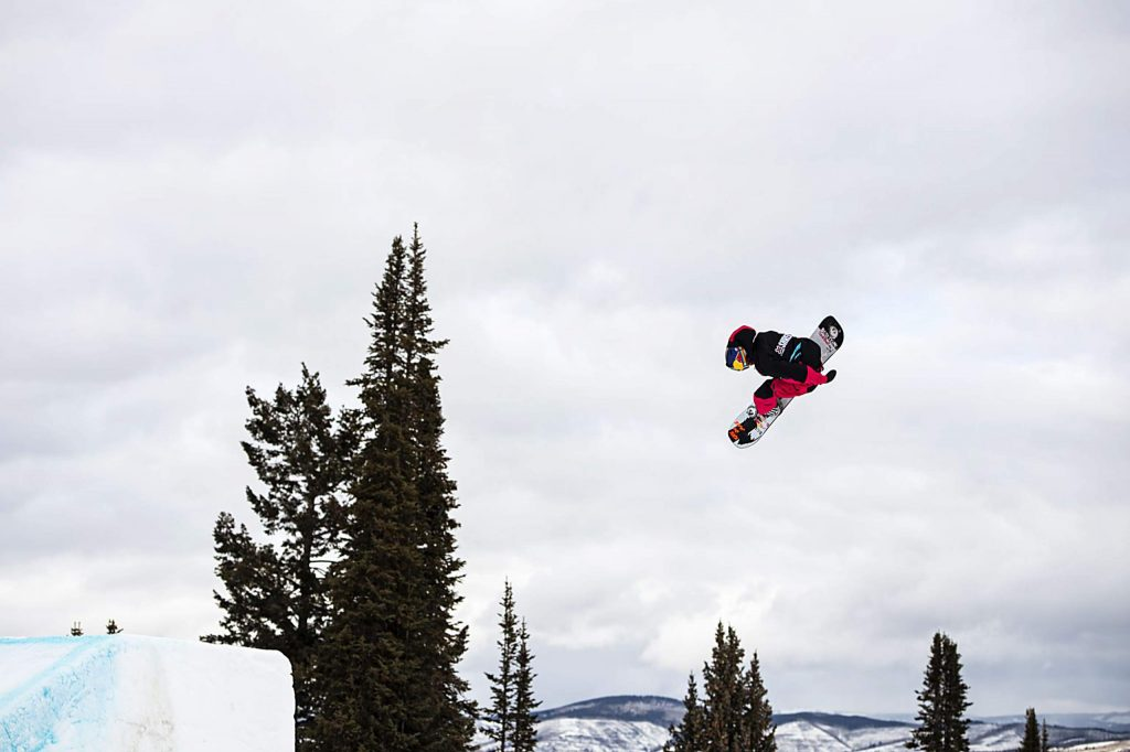 Brock Crouch hits a jump during the men's snowboard slopestyle finals on Saturday, Jan. 25.