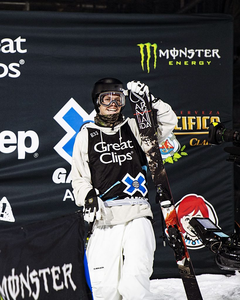 Cassidy Jarrell watches the screen after finishing his second run as the ranking update and a replay plays during the men's ski superpipe qualifier on Friday, Jan. 24, 2020. (Kelsey Brunner/The Aspen Times)
