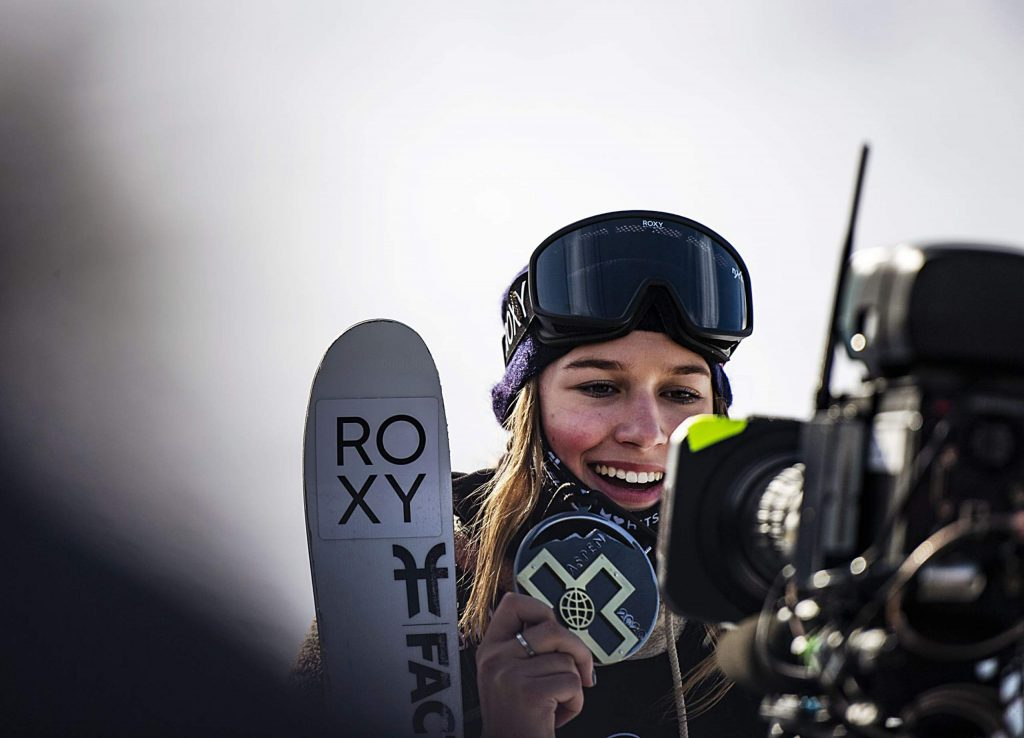 X Games gold medalist Kelly Sildaru holds up her second gold medal of the week on Sunday, Jan. 26, 2020. (Kelsey Brunner/The Aspen Times)