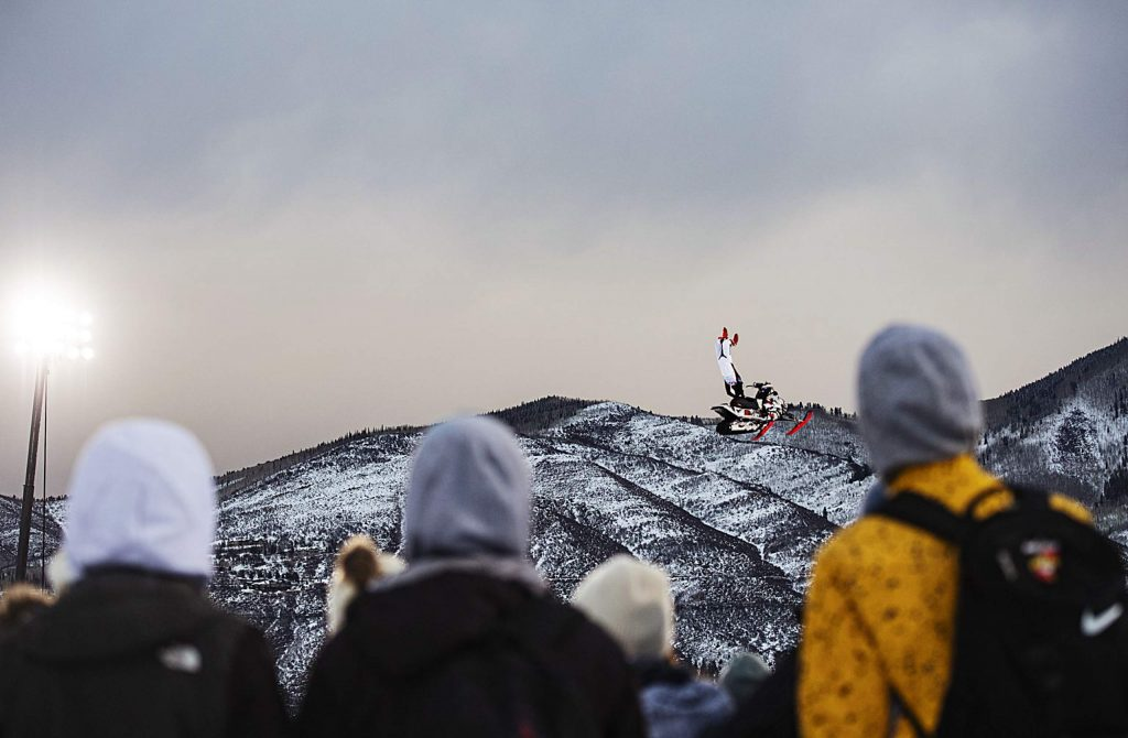 X Games rookie Brandon Cormier performs during his first run of the Snowmobile Freestyle Final on Friday, Jan. 24, 2020. Cormier took home the gold. (Kelsey Brunner/The Aspen Times)
