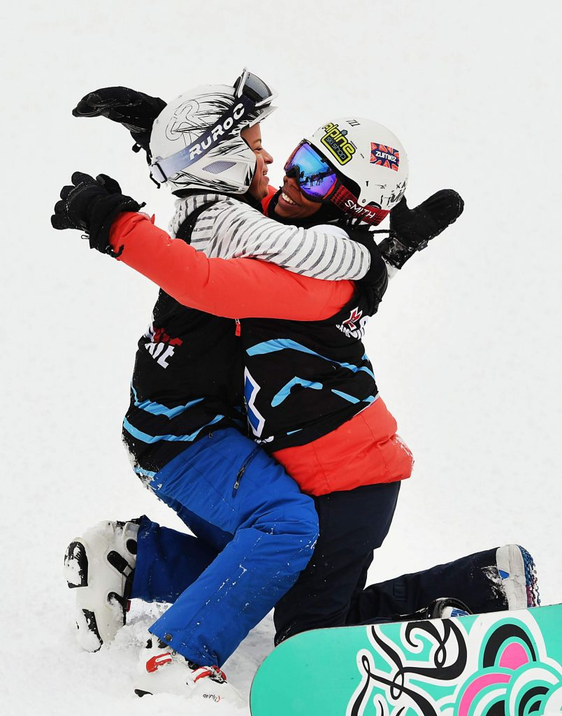 Daina Shilts, left, hugs competitor Latrice Pringle after racing each other during the X Games Special Olympics Unified Snowboarding event on Thursday, Jan. 23, 2020. (Kelsey Brunner/The Aspen Times)