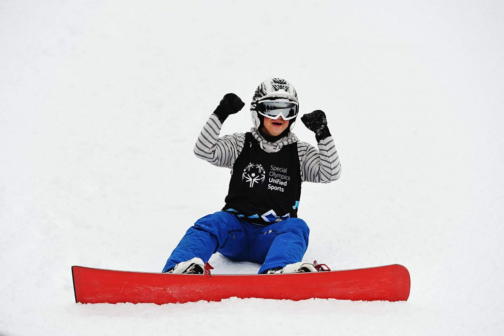 Daina Shilts celebrates after winning her first heat of the X Games Special Olympics Dual Slalom Snowboard event on Thursday, Jan. 23, 2020. (Kelsey Brunner/The Aspen Times)