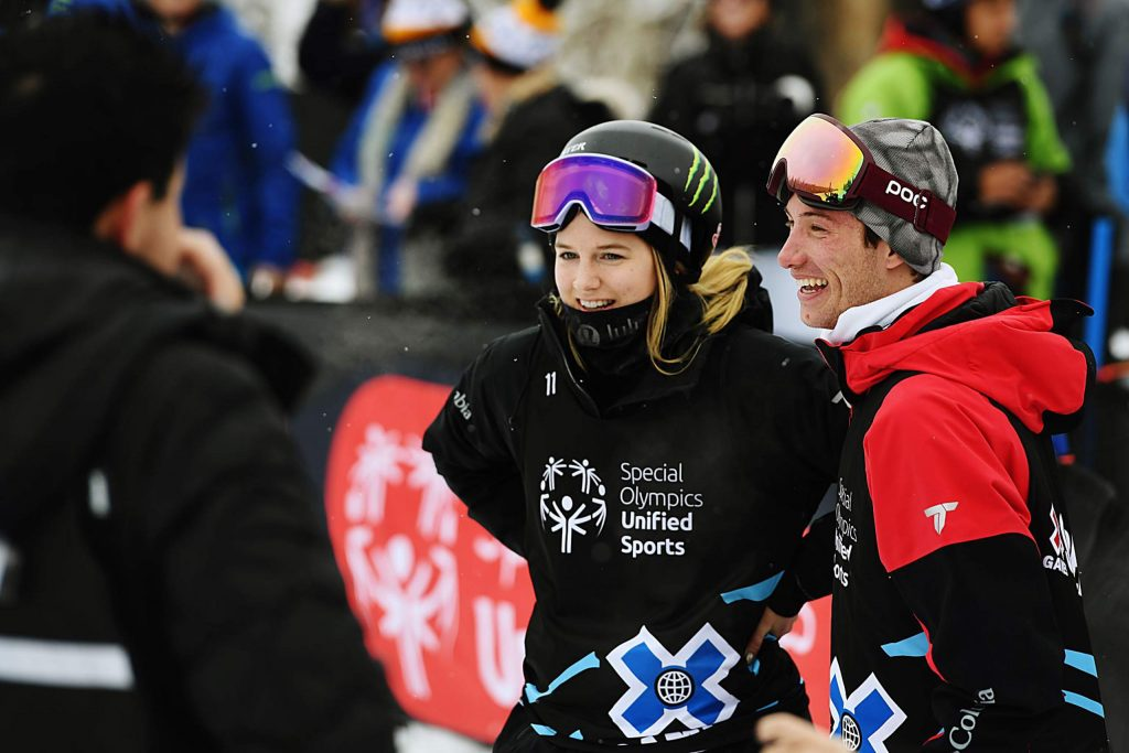 X Games athletes Cassie Sharpe, left, and Alex Ferreira stand at the base of the slalom ski course after their heat during the Special Olympics Unified event on Thursday, Jan. 23, 2020. (Kelsey Brunner/The Aspen Times)