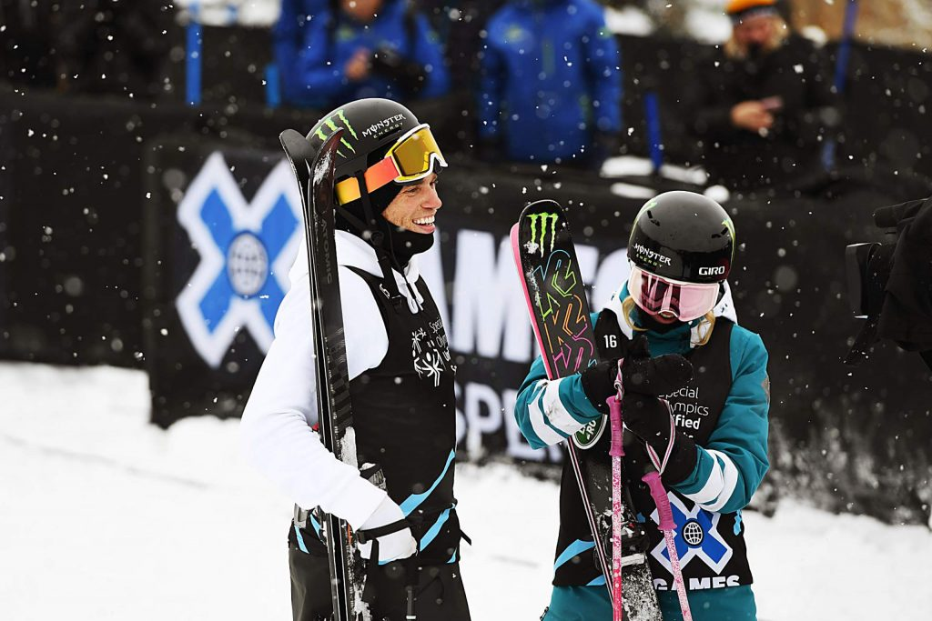 X Games athletes Gus Kenworthy, left, and Maggie Voisin stand at the base of the slalom ski course after their heat during the Special Olympics Unified event on Thursday, Jan. 23, 2020. (Kelsey Brunner/The Aspen Times)