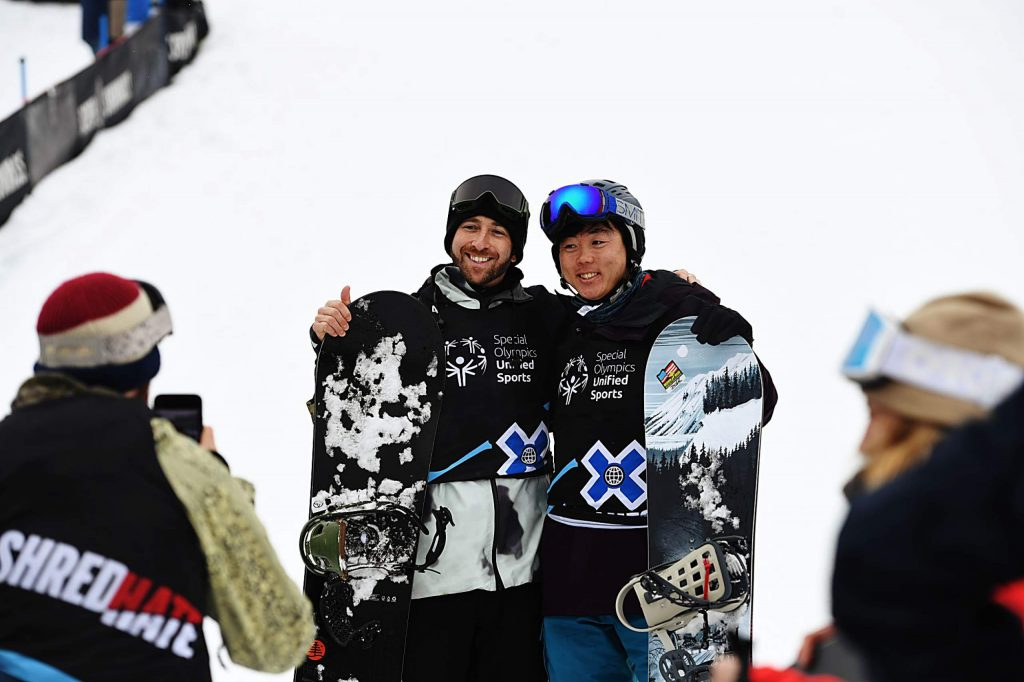 Teammates Jack Mitrani, left, and Henry Meece pose for photos at the base of the slalom snowboard course during the X Games Special Olympics Unified event on Thursday, Jan. 23, 2020. (Kelsey Brunner/The Aspen Times)