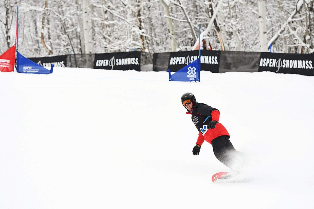 Athlete Cody Field snowboards to the bottom of the slalom course during the X Games Special Olympics Unified event on Thursday, Jan. 23, 2020. (Kelsey Brunner/The Aspen Times)
