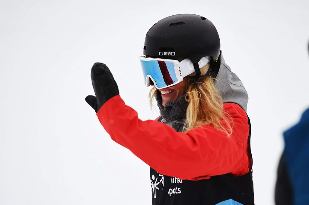 Gretchen Bleiler waves after getting to the bottom of the slalom snowboard event during the X Games Special Olympics Unified event on Thursday, Jan. 23, 2020. (Kelsey Brunner/The Aspen Times)