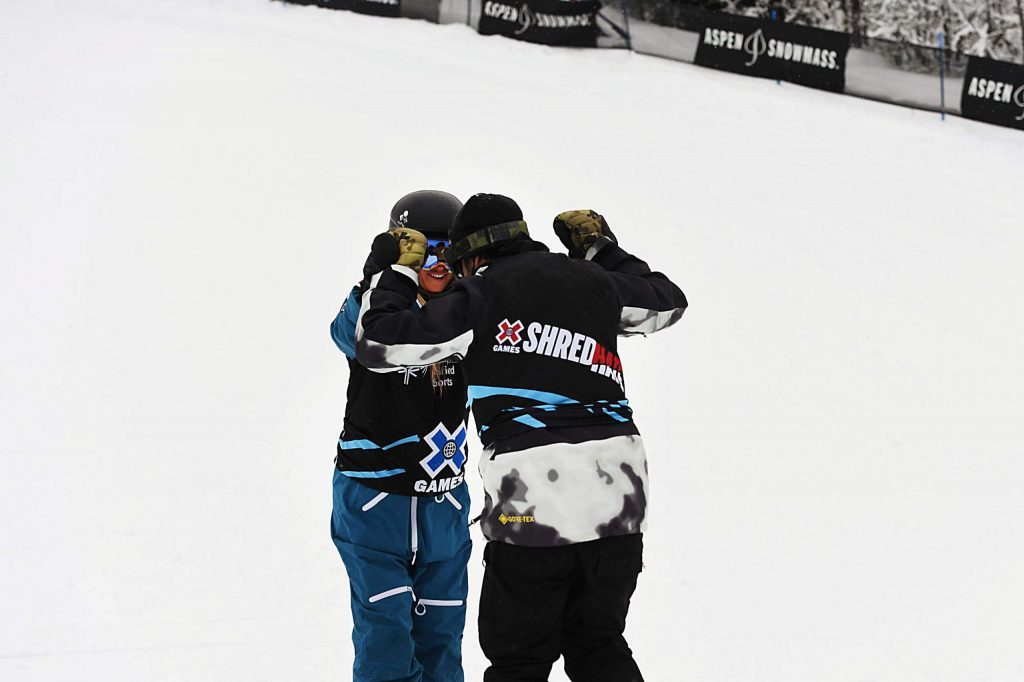 Hannah Teter and Jack Mitrani high-five after racing during the X Games Special Olympics Unified event on Thursday, Jan. 23, 2020. (Kelsey Brunner/The Aspen Times)