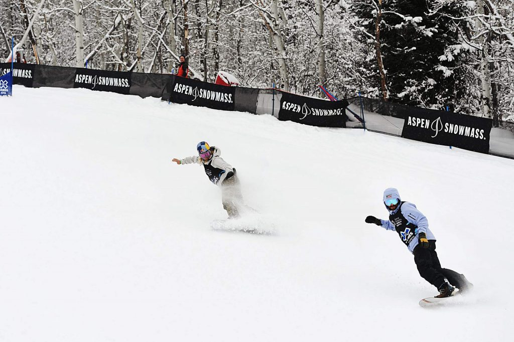 X Games Anna Gasser, left, and Danny Davis race to the bottom of the slalom snowboard course during the Special Olympics Unified event on Thursday, Jan. 23, 2020. (Kelsey Brunner/The Aspen Times)