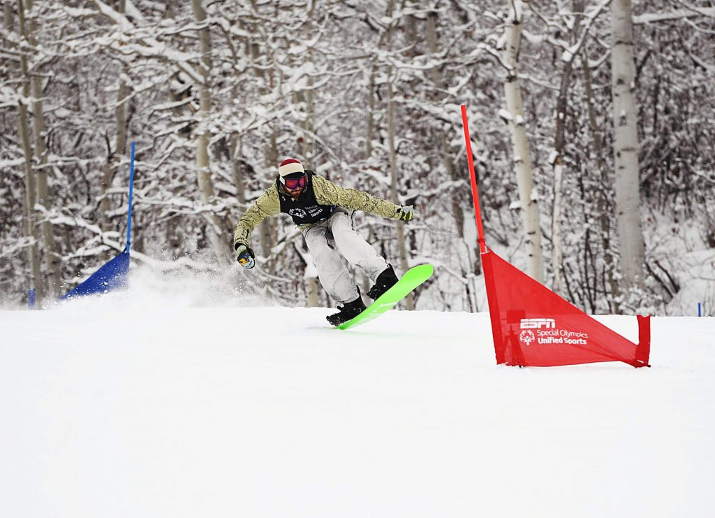 Scotty Lago snowboards to the bottom of the X Games Special Olympics Unified slalom course on Thursday, Jan. 23, 2020. (Kelsey Brunner/The Aspen Times)