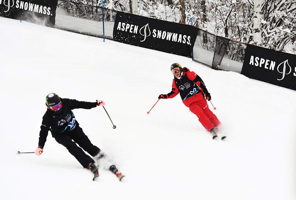 Cassie Sharpe, left, and Alex Ferreira ski into the base of the X Games Special Olympics Unified slalom course on Thursday, Jan. 23, 2020. (Kelsey Brunner/The Aspen Times)