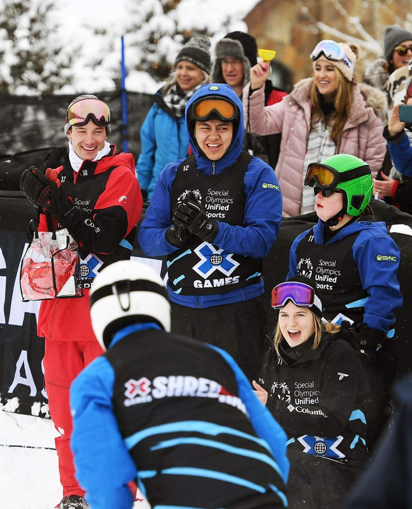 A crowd cheers along with athletes as they race in the X Games Special Olympics Unified slalom races on Thursday, Jan. 23, 2020. (Kelsey Brunner/The Aspen Times)