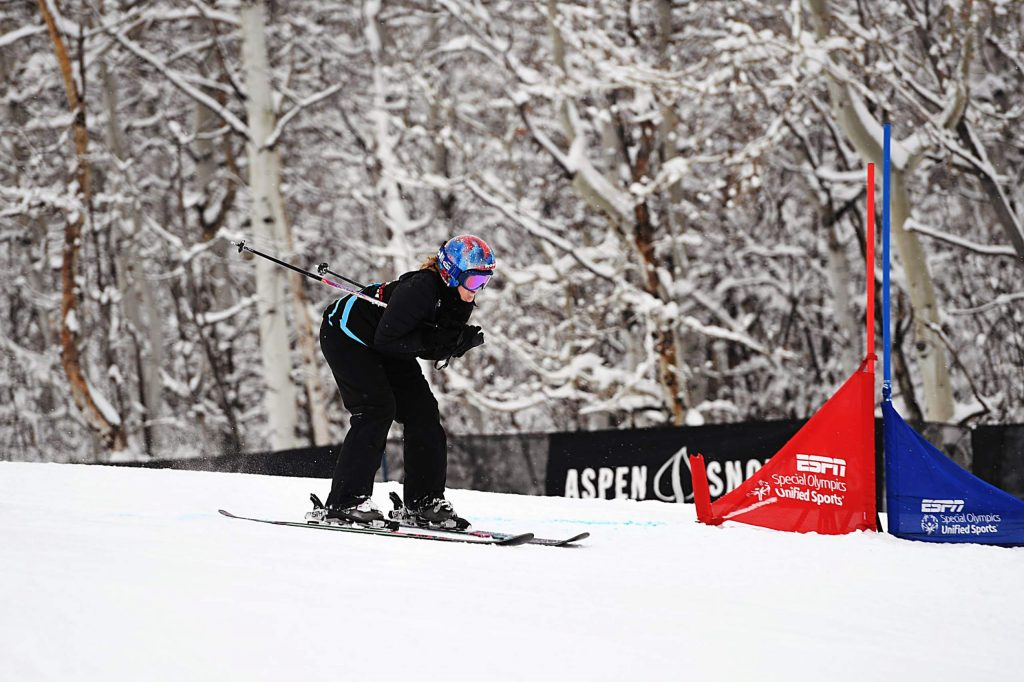 A skier races to the bottom of the X Games Special Olympics Unified slalom course on Thursday, Jan. 23, 2020.