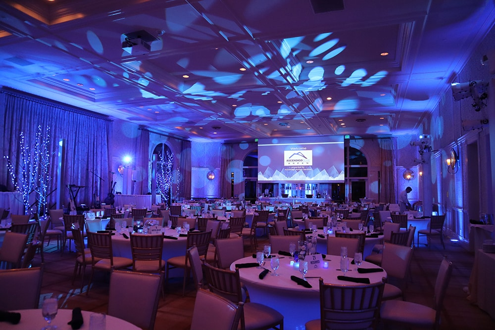 The Jerome Ballroom awash in a blue hue representing austism awareness.
