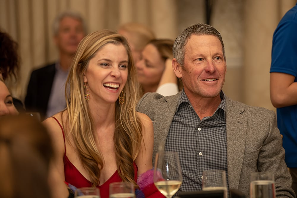 Anna Hansen and Lance Armstrong who have one kid who loves going to the AYC and one who looks forward to it when she's old enough.