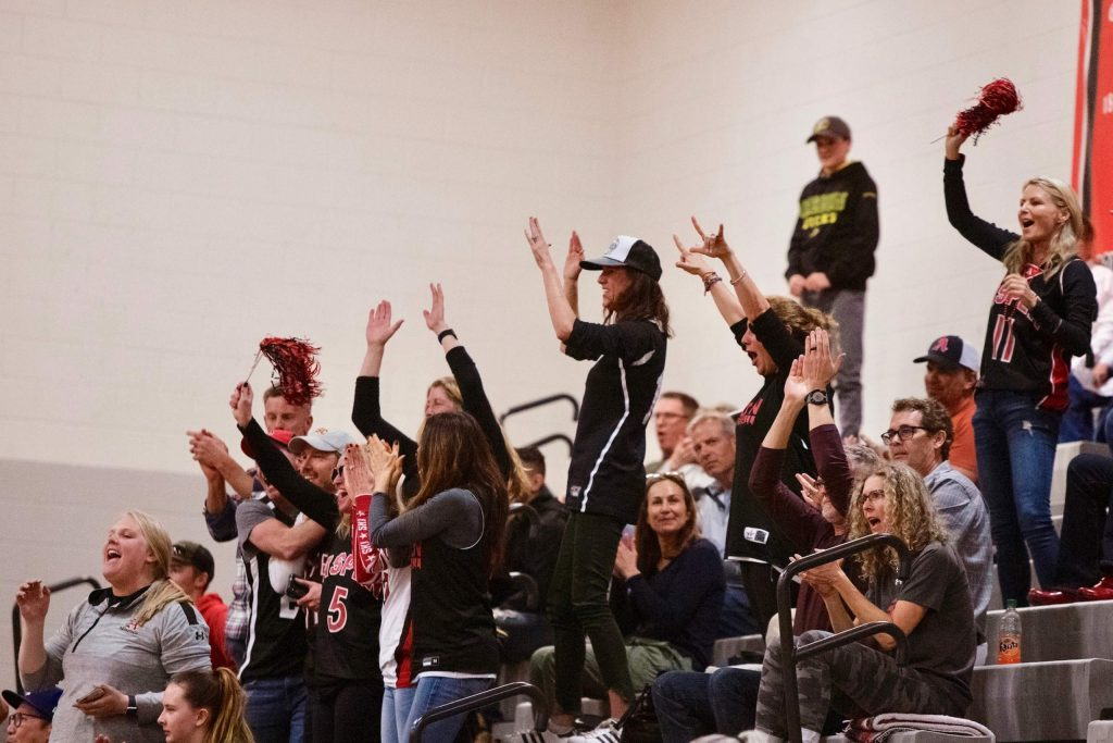 Aspen fans react to a play during the Class 3A district title game against Gunnison at Central High School in Grand Junction on Saturday, Feb. 29, 2020.