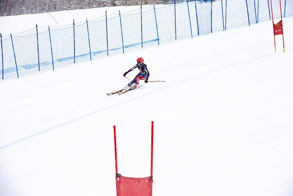 A skier for Aspen High School's Alpine Team competes in the first run of the Giant Slalom State Qualifier at Aspen Highlands on Thursday, Feb. 6, 2020. (Kelsey Brunner/The Aspen Times)