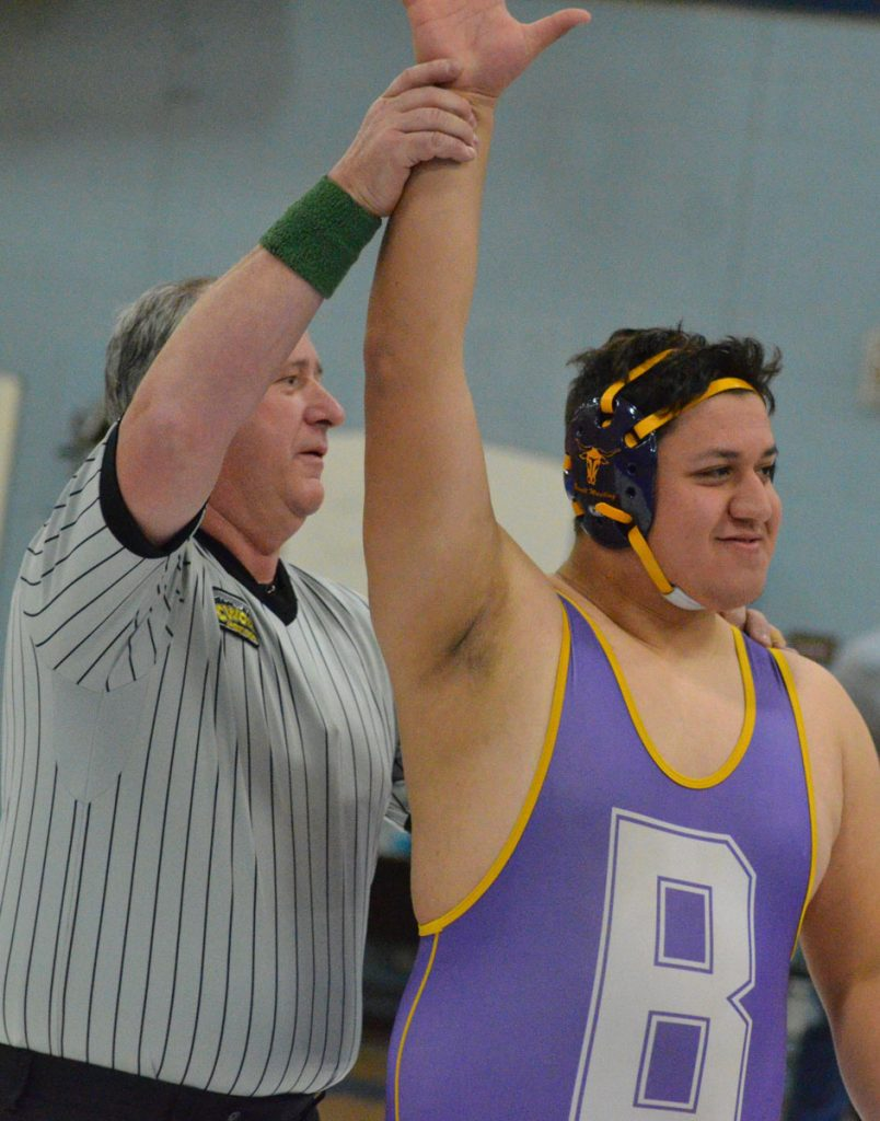 Basalt senior Ernesto Lopez has his hand raised in victory after a match earlier this season. The heavyweight is headed back to the state tournament for the second time.