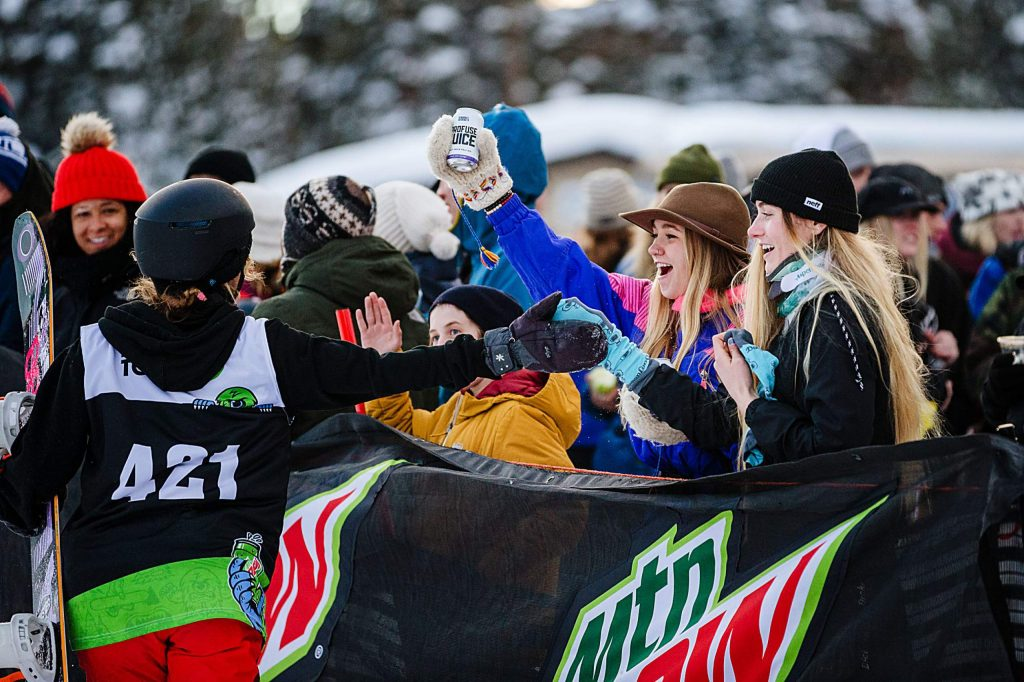 Silvia Mittermueller high fives fans after her run in the women's snowboard streetstyle competition on Saturday, Feb. 8, day three of the Winter Dew Tour at Copper Mountain.