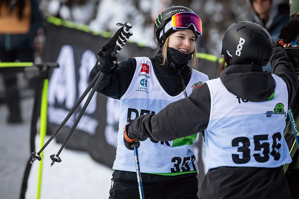 Gold medalist Cassie Sharpe gives silver medalist Rachael Karker a hug at the bottom of the slope in the women's ski modified superpipe competition on Saturday, Feb. 8, day three of the Winter Dew Tour at Copper Mountain.