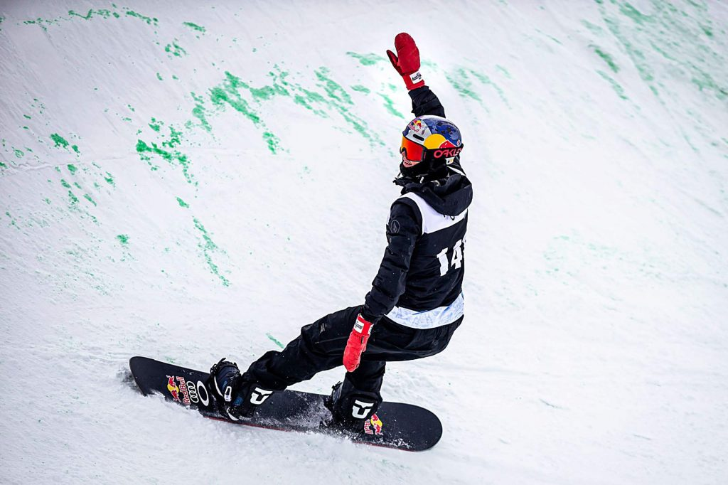Australian Scotty James raises his boxing-glove mitten in the air to celebrate his eleventh-straight snowboard superpipe win with a score of 95.33 at Copper Mountain's Winter Dew Tour on Sunday, Feb. 9.