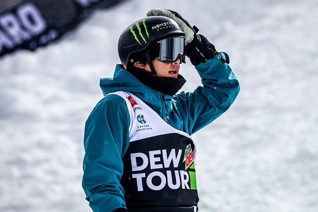 Japan's Yuto Totsuka looks up at his second-place score in the men's snowboard modified superpipe final on Sunday, Feb. 9, day four of the Winter Dew Tour at Copper Mountain.