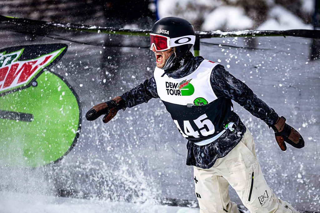 Switzerland's Pat Burgener celebrates after a strong third-place run in the men's snowboard modified superpipe with a score of 91.00 on Sunday, Feb. 9, day four of the Winter Dew Tour at Copper Mountain.