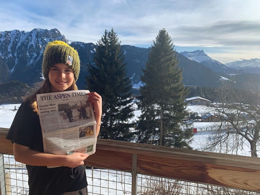 Lucy Faulhaber displays an Aspen Times while in Leysin, Switzerland, where she supported her big sister and rising half-pipe star Hanna Leysin, who competed in the Youth Olympic Games.