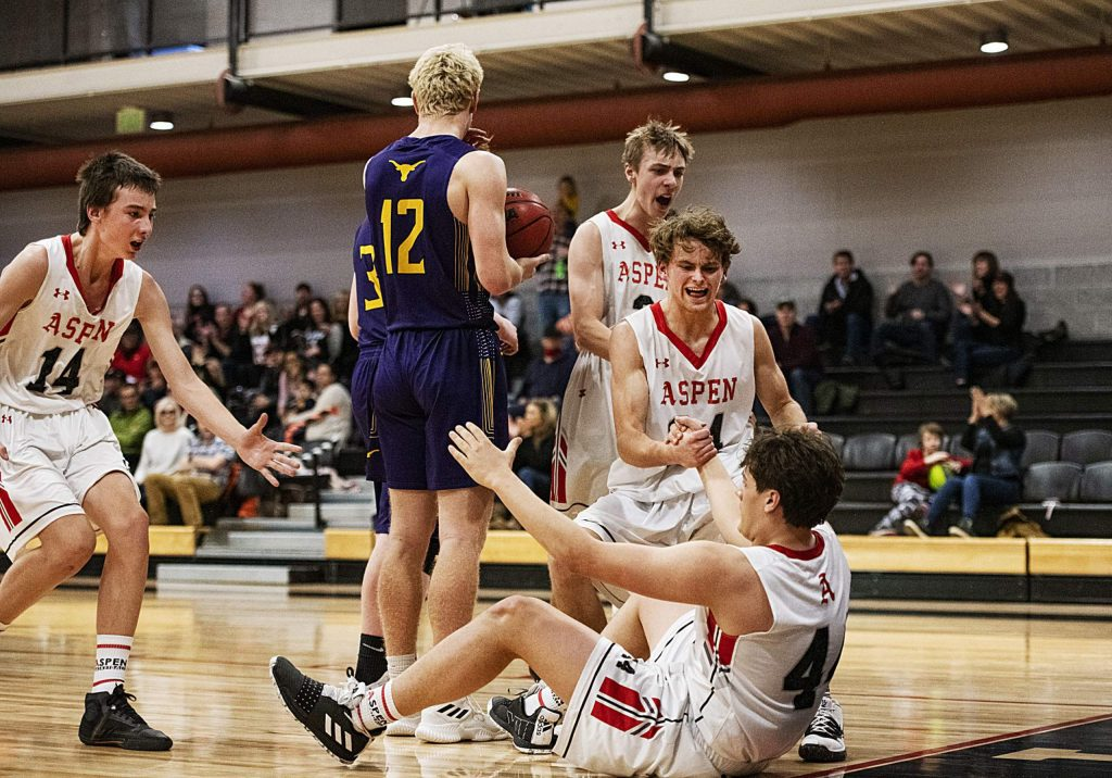 Teammates help up Aspen's Aidan Ledingham during the game against Basalt on Thursday, Feb. 20, 2020. (Kelsey Brunner/The Aspen Times)